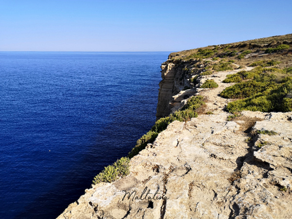 trekking alonside cliffs malta